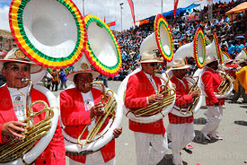 Poopo brass band playing sousaphones during parades, Oruro Carnival, Bolivia