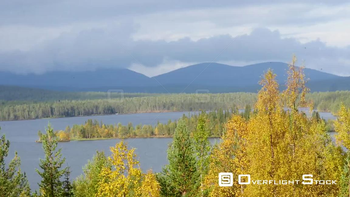 Autumn Color Landscape, Pan Time Lapse of Autumn Trees, a Lake and Fjeld Tunturi Mountains, on a Sunny and Rainy Fall Day, in...