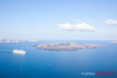 Cruise ship near volcanic island in Santorini Greece