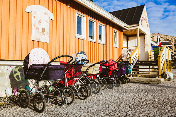 Strollers are parked in front of the school in Uummannaq, a frequently seen view in Greenland!