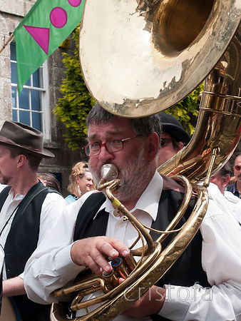 visiting Breton band member plays the sousaphone in the Mazey Day parade