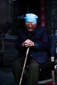 Old chinese woman crying in despair, China
