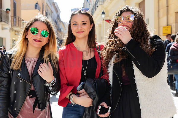 A Portrait of 3 Women During an Easter Parade at Trapani