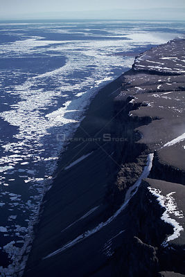Aerial view of Devon island, in summer with pack ice offshore, Canadian arctic