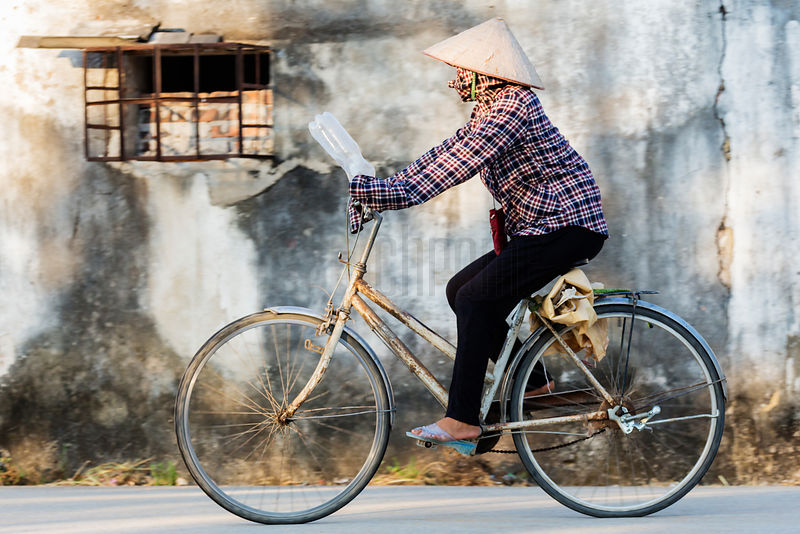Womanwith Traditional Hat on Bicycle