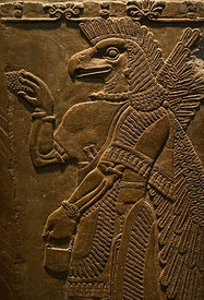 Sculptured wall relief depicting an Eagle headed protective Spirit from Temple of Ninurta at Nimrud the Assyrian capital in N...