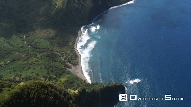 Steep look down from a flight along the rugged coast of Molokai.