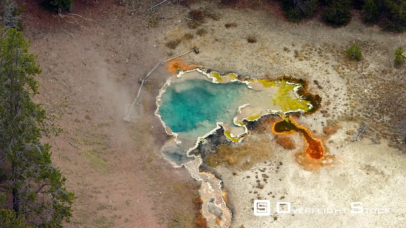 Octopus Spring showcases its deep turquoise, yellow and orange colors in the Lower Geyser Basin, in Yellowstone National Park