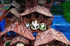 Stables and baby Jesus figures for nativity scenes for sale in Christmas market, La Paz, Bolivia