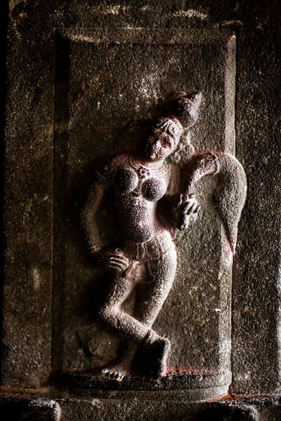 India - Swamimalai - Detail of a stone carving depicting a deity in the Chola style with a fly whisk