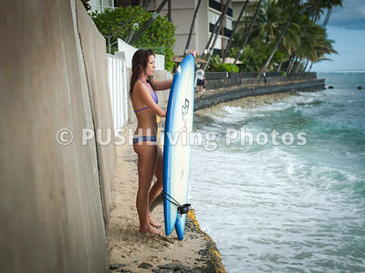 Young woman sufer with her board observing the ocean