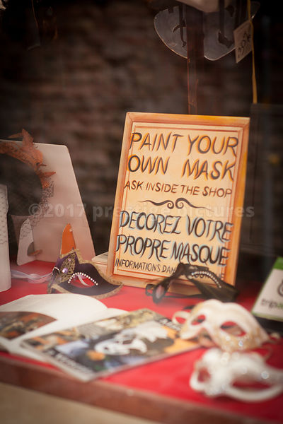 Sign inviting Customers to Paint their own Carnival Masks