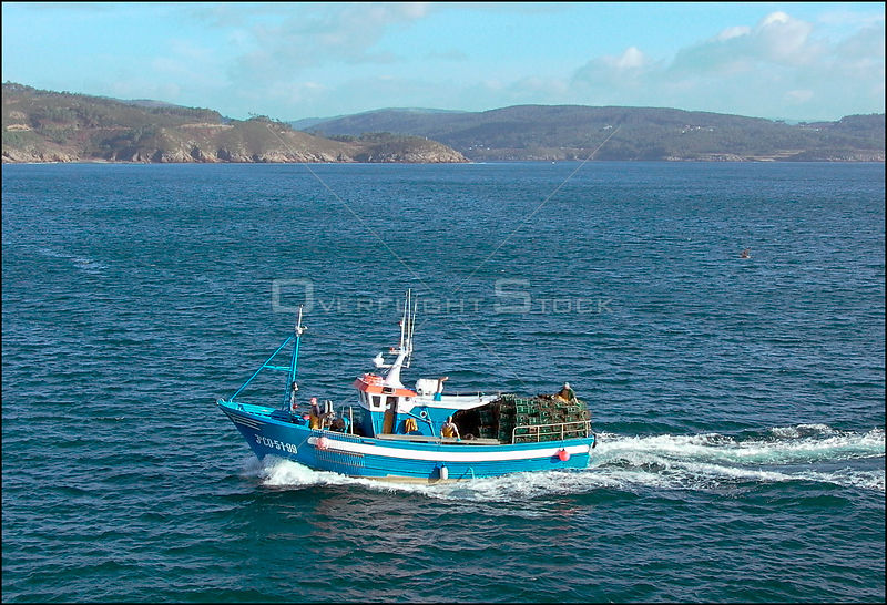 SPAIN Finisterre -- 05/12/2002 -- Fishing boat returns to Finisterre. On this day the fishermen were permitted to collect the...