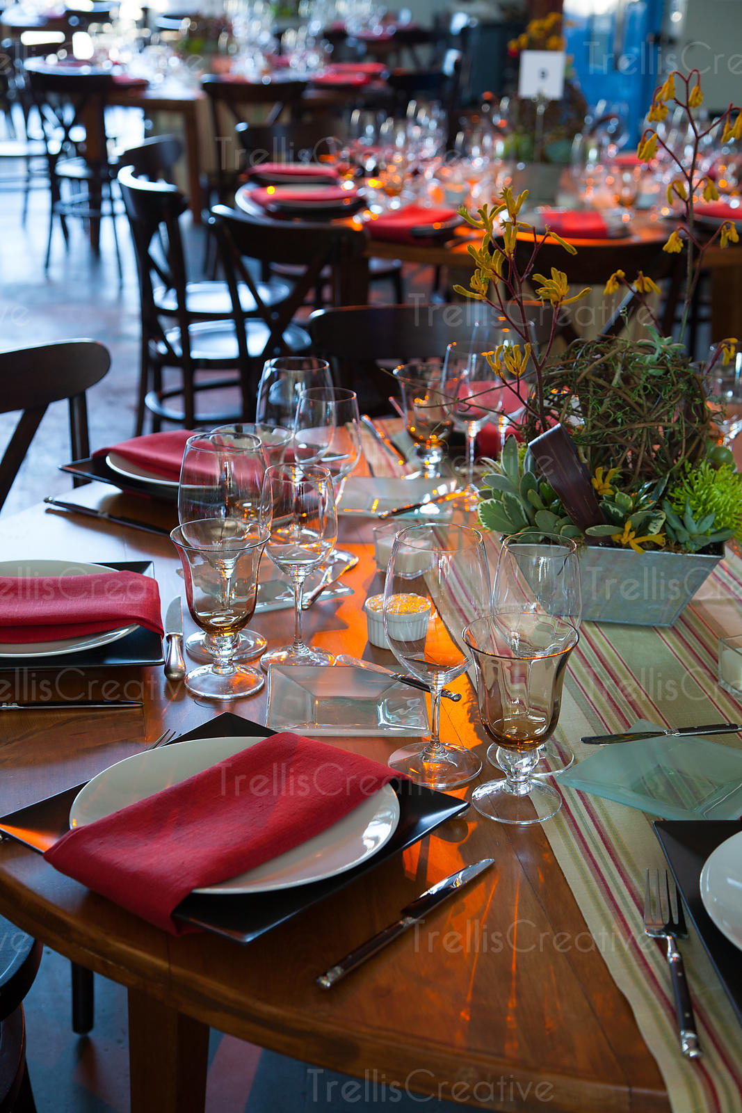 Elegantly decorated tables wait for party guests to arrive