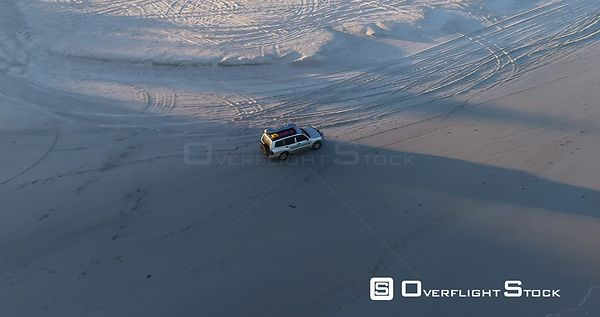 SUV Truck Driving on Nanarup Beach at Sunrise Western Australia