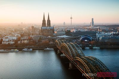 Bridge and city skyline at sunset, Cologne, Germany