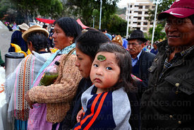 Young girl with coca leaf stuck on her forehead (a common local cure for headaches) , La Paz , Bolivia