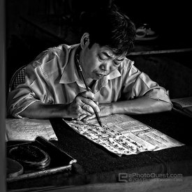 Man Writing in Temple Grounds