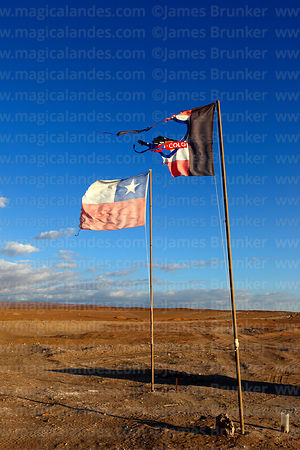 National and Colo Colo football team flags in the Atacama Desert near Pica, Region I, Chile