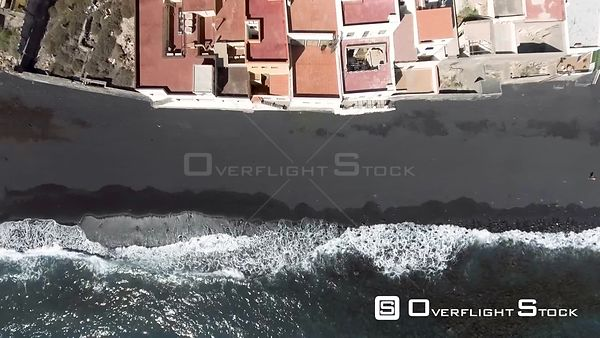 Downward aerial view of volcanic beach Tenerife Spain