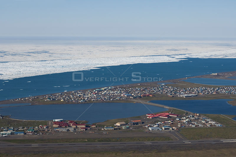 Aerial view of the Inupiat village of Barrow during the Spring ice breakup. National Petroleum Reserves, Arctic coast of Alaska