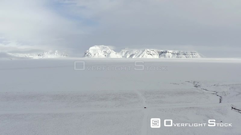Distant Mountain Across a Lava Field in Iceland Covered in Snow