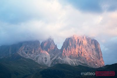 Langkofel peaks in the clouds in summer Dolomites Italy