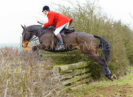 Nicholas Leeming MFH jumps a hedge away from the meet at Ladywood Lodge