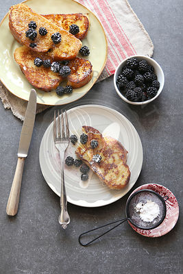 French toast with honey,fresh blackberries and dusted with icing sugar