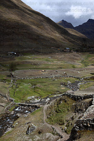 Old rustic stone bridge across stream near Canisaya , Cordillera Apolobamba , Bolivia