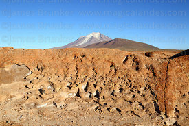 Eroded volcanic lava flow and Cerro Ollagüe volcano, Nor Lípez Province, Bolivia