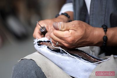 Chinese shoemaker at work