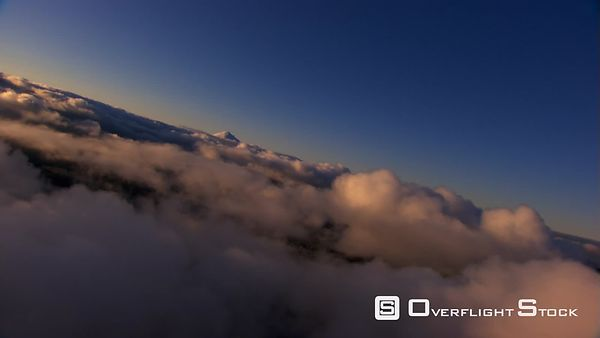 Veering flight over fluffy clouds