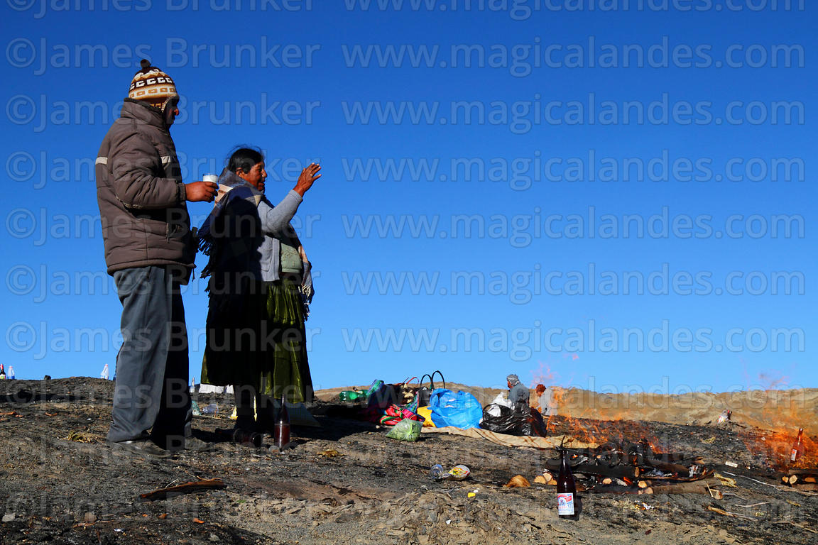 A couple praying while burning offering (called a k'oa) to Pachamama, La Cumbre, Cordillera Real, Bolivia