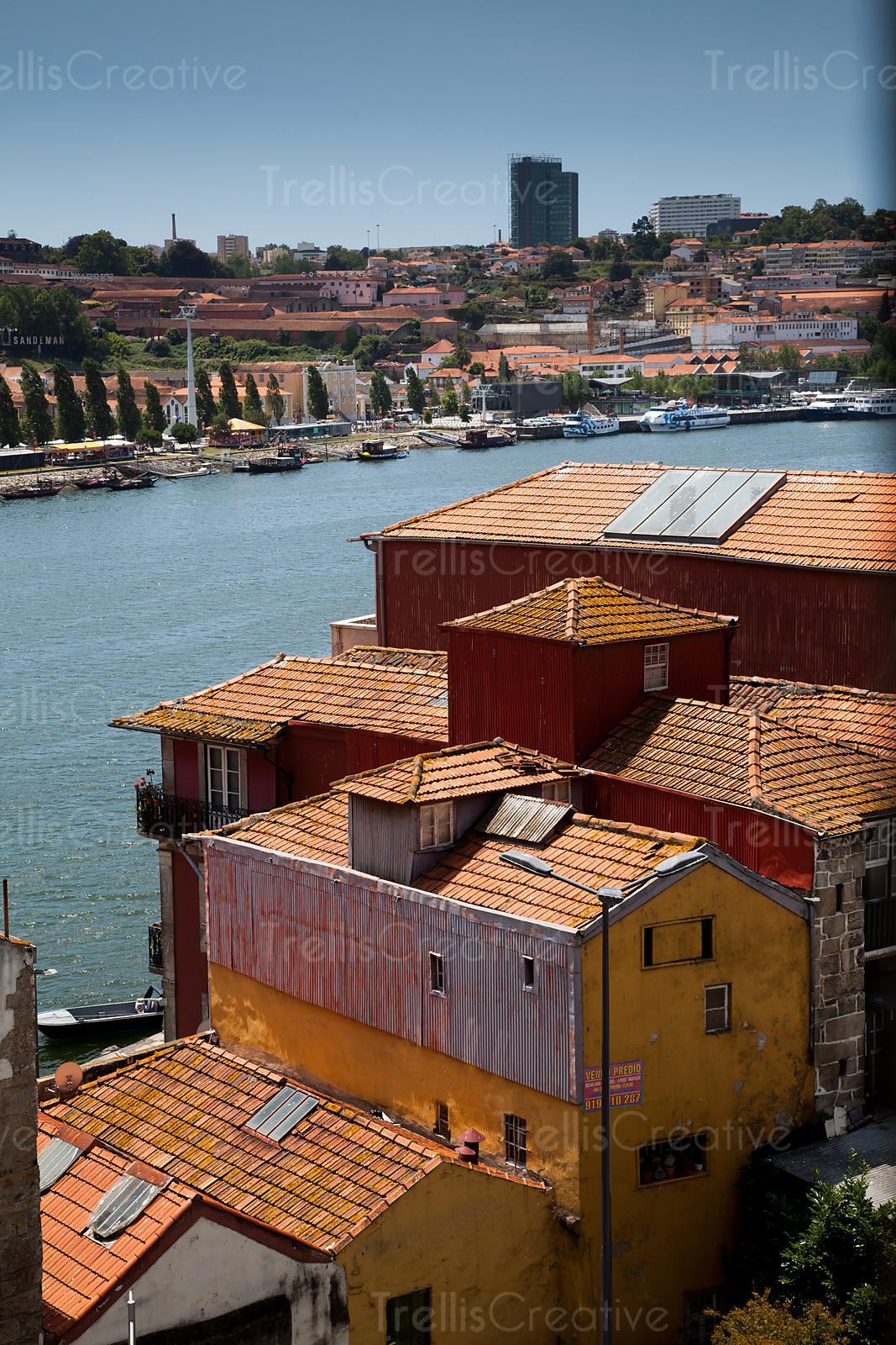 Old buildings line the Douro river in Porto, Portugal.