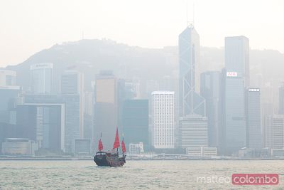 Chinese junk boat sailing in Hong Kong harbor