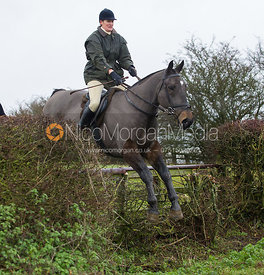 Debbie Barnes jumping near the new Jubilee Covert - Cottesmore Hunt at Deane Bank Farm 4/12/12