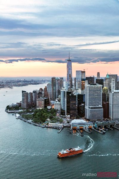 Aerial of lower Manhattan skyline with Staten Island ferry boat, New York, USA
