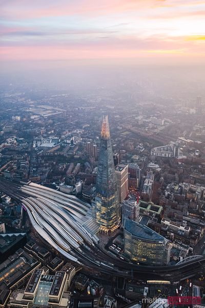 Aerial view of the Shard illuminated at dusk, London