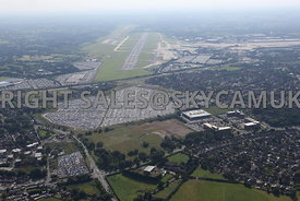 Looking across towards the runways at Manchester Airport and the car parks and Ringway Trading Estate and Atlas Business Park...