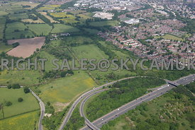 High level view across the M56 motorway Junction 5 towards Farmland Roaring Gate Lane and Thorley Lane to the west of Manches...