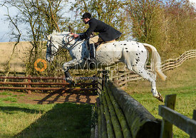 Tim Dobson-Seaton jumping a fence. Quorn Hunt Opening Meet 2018