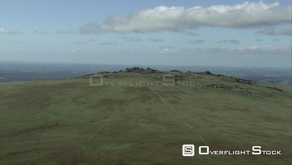 Aerial view tracking towards Great Mis Tor, Dartmoor National Park, Devon, England, UK, October 2015.