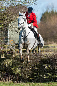 Andrew Osborne MFH jumping the first hedge