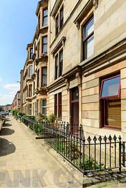 GLASGOW, SCOTLAND - AUGUST 16, 2016: A sandstone residential building in White Street, off Byers Road in the West End of Glas...