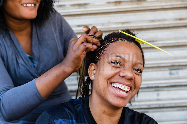 Woman Having Braids put in her Hair