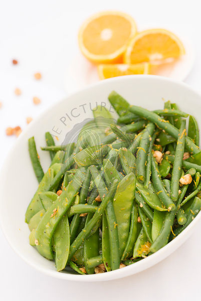 Green sweet pea, bean, hazelnut and orange salad
