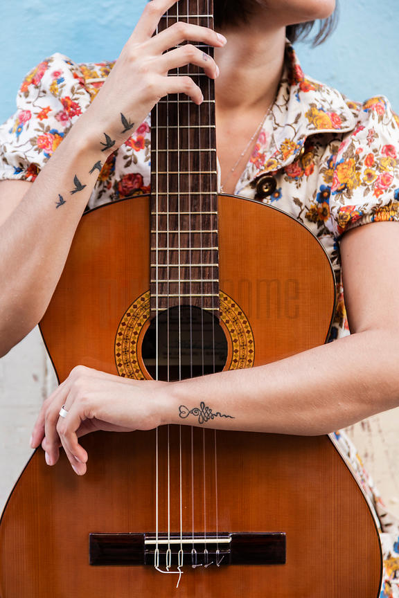 Portrait of a Musician with a Guitar