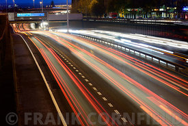 GLASGOW, SCOTLAND – NOVEMBER 30, 2015: Streaks of coloured light from vehicles travelling during a winter rush hour on the M8...