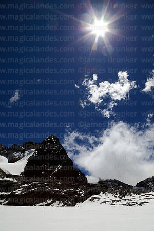 Sun above the Cerro Wila Mankilisani glacier, Cordillera Real, Bolivia